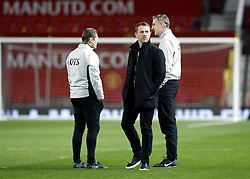 """Derby County coach Kevin Poole (left) and first team coach Mark Sale (right) with manager Gary Rowett (centre)  prior to the FA Cup, third round match at Old Trafford, Manchester. PRESS ASSOCIATION Photo. Picture date: Friday January 5, 2018. See PA story SOCCER Man Utd. Photo credit should read: Martin Rickett/PA Wire. RESTRICTIONS: EDITORIAL USE ONLY No use with unauthorised audio, video, data, fixture lists, club/league logos or """"live"""" services. Online in-match use limited to 75 images, no video emulation. No use in betting, games or single club/league/player publications."""
