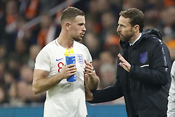 (L-R) Jordan Henderson of England, coach Gareth Southgate of England during the International friendly match match between The Netherlands and England at the Amsterdam Arena on March 23, 2018 in Amsterdam, The Netherlands