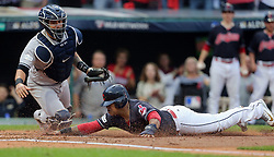 October 6, 2017 - Cleveland, OH, USA - The Cleveland Indians' Jose Ramirez, right, beats the tag from New York Yankees catcher Gary Sanchez to score on Carlos Santana's first-inning hit during Game 2 of the American League Division Series, Friday, Oct. 6, 2017, at Progressive Field in Cleveland. (Credit Image: © Phil Masturzo/TNS via ZUMA Wire)