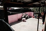Il cortile di un'appartamento abitato da indiani sikh, Sabaudia (Latina), Giugno 2014.  Christian Mantuano / OneShot