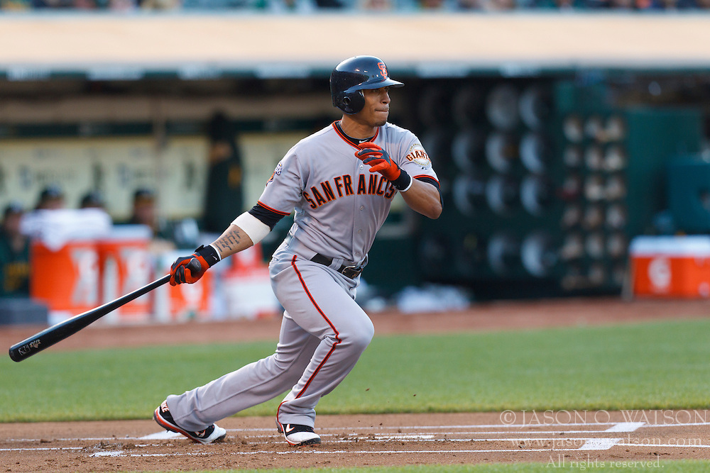 June 18, 2011; Oakland, CA, USA;  San Francisco Giants second baseman Emmanuel Burriss (2) at bat against the Oakland Athletics during the first inning at the O.co Coliseum.  Oakland defeated San Francisco 4-2.