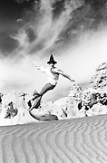 Witch clothing jumping on sand dune- One Woman Show