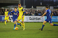 AFC Wimbledon defender Barry Fuller (2) and AFC Wimbledon midfielder Jake Reeves (8) tackling Oxford United striker Ryan Taylor (20) during the EFL Sky Bet League 1 match between AFC Wimbledon and Oxford United at the Cherry Red Records Stadium, Kingston, England on 14 January 2017. Photo by Matthew Redman.