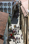 Tourists and pilgrims in alleyways of Santiago de Compostela, Galicia, Spain