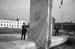 Garda Memorial Unveiled. Mr. Brian Lenihan T.D., Minister for Justice, unveils a Memorial to members of the force who gave their lives in the service of their country, at the Garda Headquarters, Phoenix Park, Dublin..21.10.1966