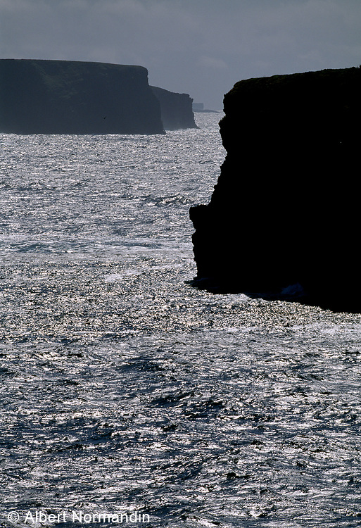 The Cliffs of Moher with silver blue sea