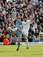 Photo: Kevin Poolman.<br />Milton Keynes Dons v Tranmere Rovers. Coca Cola League 1. 29/04/2006. Tranmere's Chris Greenacre and Craig Morgan (MK) fight over the ball.