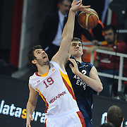 Galatasaray's Furkan ALDEMIR (L) and Anadolu Efes's Stanko BARAC (R) during their BEKO Basketball League derby match Galatasaray between Anadolu Efes at the Abdi Ipekci Arena in Istanbul at Turkey on Sunday, November 13 2011. Photo by TURKPIX