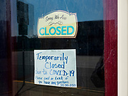 "26 APRIL 2020 - JEWELL, IOWA: A business in Jewell closed because of the COVID-19 pandemic. Jewell, a small community in central Iowa, became a food desert when the only grocery store in town closed in 2019. It served four communities within a 20 mile radius of Jewell. Some of the town's residents are trying to reopen the store, they are selling shares to form a co-op, and they hold regular fund raisers. Sunday, they served 550 ""grab and go"" pork roast dinners. They charged a free will donation for the dinners. Despite the state wide restriction on large gatherings because of the COVID-19 pandemic, the event drew hundreds of people, who stayed in their cars while volunteers wearing masks collected money and brought food out to them. Organizers say they've raised about $180,000 of their $225,000 goal and they hope to open the new grocery store before summer.            PHOTO BY JACK KURTZ"