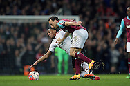 Mark Noble of West Ham United pushes Anthony Martial of Manchester United. The Emirates FA cup, 6th round replay match, West Ham Utd v Manchester Utd at the Boleyn Ground, Upton Park  in London on Wednesday 13th April 2016.<br /> pic by John Patrick Fletcher, Andrew Orchard sports photography.