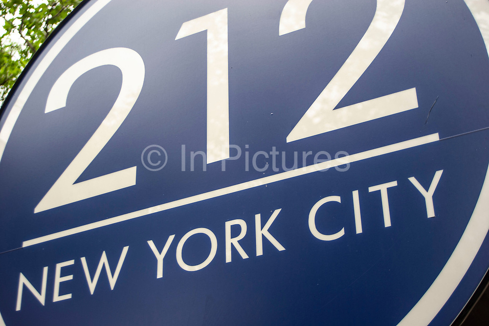 Sign for the 212 restaurant on 133 East 65th Street, named after New York Citys most famous zip code on 19th May 2007 in New York City, United States.