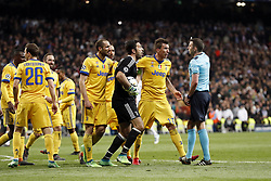(L-R) Blaise Matuidi of Juventus FC, Stephan Lichtsteiner of Juventus FC, Gonzalo Higuain of Juventus FC, Douglas Costa of Juventus FC, Giorgio Chiellini of Juventus FC, Medhi Benatia of Juventus FC, goalkeeper Gianluigi Buffon of Juventus FC, Mario Mandzukic of Juventus FC, referee Michael Oliver during the UEFA Champions League quarter final match between Real Madrid and Juventus FC at the Santiago Bernabeu stadium on April 11, 2018 in Madrid, Spain
