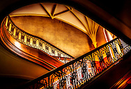 An ornate staircase leads to the upper floor of Callanwolde Fine Arts Center, which is housed within a 27,000 square foot Gothic-Tudor Revival mansion and nestled on 12 acres in Atlanta, Georgia. The house, built in 1920, was the home of Charles Howard Candler, son of the founder of the Coca-Cola Company. The house was designed by architect Henry Hornbostel. Today, Callanwolde operates as a non-profit organization devoted to teaching and promoting the visual, literary and performing arts. (Photo by Carmen K. Sisson/Cloudybright)