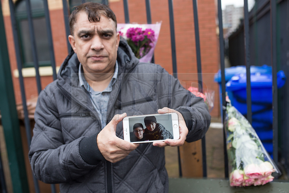 CORRECTED CAPTION © Licensed to London News Pictures . 01/03/2016 . Manchester , UK . TARIQ HUSSAIN (uncle of Shahzaib Hussain) with a photo of his son Allihan Hussain (left in the phone picture) and nephew Shahzaib Hussain (right on the phone picture) , outside the Masjid Hamza Mosque on Moss Lane West in Ashton Under Lyne . 11 year old Shahzaib Hussain was killed by a hit and run driver yesterday evening (Monday 29th February 2016) . Photo credit : Joel Goodman/LNP
