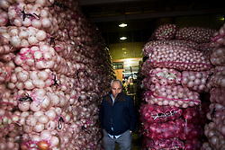 A man walks through the Central de Abasto, Mexico's main fruit and vegetable market, on Tuesday, October 20, 2009, in Mexico City, Mexico.