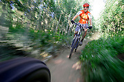 M.O. Alford, 35, of Nederland, Co. flies down a trail named Aspen Alley in the West Magnolia Trail System near Nederland on Wednesday August 2, 2006. The eight to ten miles of trails in the system were ridden illegally for a number of years until the Forest Service incorporated the trails into their system about two years ago. Alford volunteers with the Boulder Mountain Bike Patrol (part of the Boulder Mountain Bike Alliance) on weekends to educate riders about access issues in the area and ensure resource conservation in the area..(MARC PISCOTTY/ © 2006)