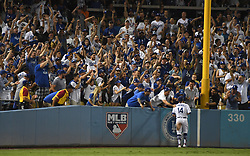 October 24, 2017 - Los Angeles, California, U.S. - Los Angeles Dodgers left fielder Enrique Hernandez is patted on the back by fans after catching a drive by Houston Astros Josh Reddick (not pictured) in the seventh  inning of game one of a World Series baseball game at Dodger Stadium on Tuesday, Oct. 24, 2017 in Los Angeles. Dodgers won 3-1. (Photo by Keith Birmingham, Pasadena Star-News/SCNG) (Credit Image: © San Gabriel Valley Tribune via ZUMA Wire)