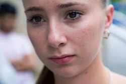 Teenaged girl looking serious,