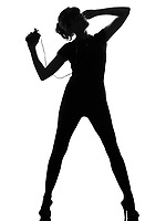 full length silhouette in shadow of a young woman ancing and listening music on mp3 audio player  in studio on white background isolated