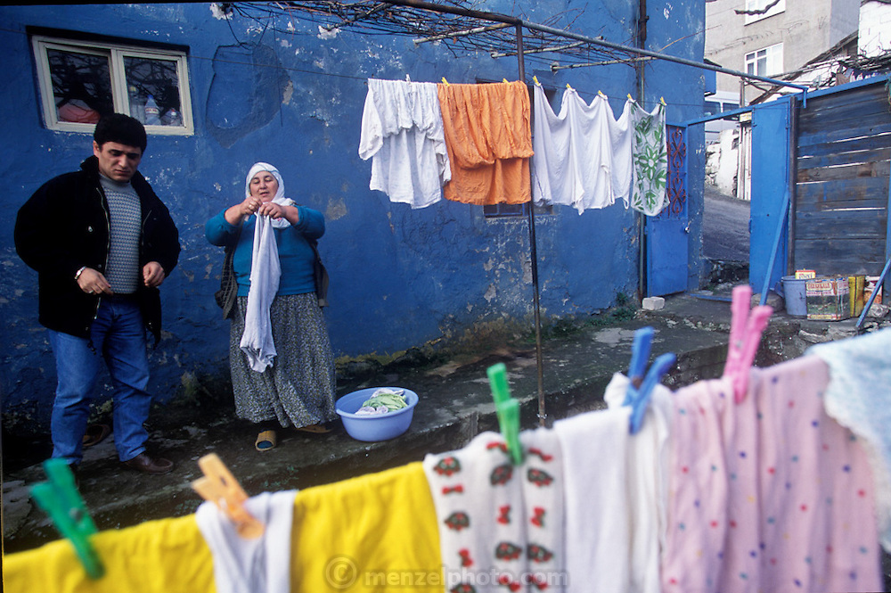 (MODEL RELEASED IMAGE). In the Golden Horn area of Istanbul, Turkey, Safiye Çinar and her daughter-in-law Feriye works diligently on the family laundry. (Supporting image from the project Hungry Planet: What the World Eats.)