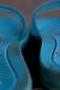 A pair of blue flip flops.
