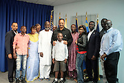 September 19, 2012- Queens, New York:  (L-R) Former Prisoner Amadou Scattred Janneh, Rev. Jesse Jackson, The Rainbow PUSH Coalition and Former Prisoner Tamsir Jasseh and family members pose for a photograph just outside JFK Terminal 1 as free men after being held as prisoners in the Gambia, West Africa. Former Prisoner Amadou Scattred Janneh, a former Professor at the University of Tennessee, who held dual US Citizenship with the Gambia, was serving a life sentence for Treason. In addition to him, Tamsir Jessah, a U.S Citizen and former U.S. Military Veteran with dual citizenship with the West African nation was also serving a twenty-year sentence for Treason. With a face-to-face appeal by Rev. Jesse L. Jackson, with the Yayha Jammeh, President of The Gambia an agreement was made to release the two American citizens into Rev. Jackson's custody who allow them to return to the United States with Jackson Tuesday night.  The two men returned to the U.S. by plane with Rev. Jackson from The Gambia to joyfully grateful waiting family members. In addition, President Jammeh has agreed to extend the moritorium on executions indefinitely, marking a significant gain for Human Rights in the West African Nation on September 19, 2012. (Terrence Jennings)