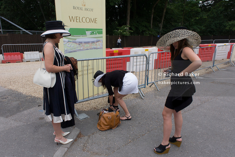 Ladies swap shoes during the annual Royal Ascot horseracing festival in Berkshire, England. Royal Ascot is one of Europe's most famous race meetings, and dates back to 1711. Queen Elizabeth and various members of the British Royal Family attend. Held every June, it's one of the main dates on the English sporting calendar and summer social season. Over 300,000 people make the annual visit to Berkshire during Royal Ascot week, making this Europe's best-attended race meeting with over £3m prize money to be won.