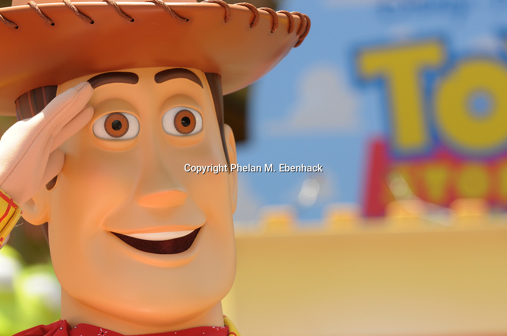 Woody salutes park guests as they walk to the Toy Story Mania! ride during the preview event at Disney's Hollywood Studios in Lake Buena Vista, Fla., Wednesday, May 14, 2008.
