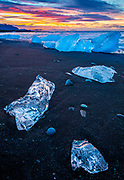 Jökulsárlón is a large glacial lake in southeast Iceland, on the edge of Vatnajökull National Park. Situated at the head of the Breiðamerkurjökull glacier, it developed into a lake after the glacier started receding from the edge of the Atlantic Ocean. The lake has grown since then at varying rates because of melting of the glaciers. It is now 1.5 kilometres (0.93 mi) away from the ocean's edge and covers an area of about 18 km2 (6.9 sq mi). It recently became the deepest lake in Iceland, at over 248 metres, as glacial retreat extended its boundaries. The size of the lake has increased fourfold since the 1970s. It is considered as one of the natural wonders of Iceland.