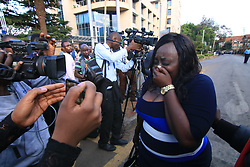 Jan 15, 2019 - Nairobi, Kenya - A woman seen crying walking next to media people after getting away from the attack..It started at around 3:30 pm when an unknown number of armed gunmen with one suicide bomber launched an attack on Dustil Hotel in Nairobi Kenya. The attack left 2 dead and several injured as the paramedics had to take action of helping the injured to safety hospitals around. (Credit Image: © Donwilson Odhiambo/SOPA Images via ZUMA Wire)