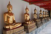 Wat Po Temple of the Reclining Buddha Bangkok Thailand golden Buddha statues