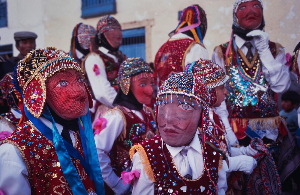 Masked dancers mimicking the Spanish at the festival of Corpus Cristi at Paucartambo,Cuzco region.