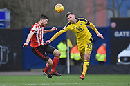 Sunderland defender Jack Baldwin (15) and Oxford United forward James Henry (17) battle for the header during the EFL Sky Bet League 1 match between Oxford United and Sunderland at the Kassam Stadium, Oxford, England on 9 February 2019.