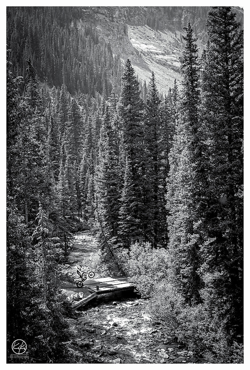 {Colorado : Devil's Playground : 2013} I've been working a lot on compiling my black & white scans and digital images into a gallery for my website. In doing so, I have brought back many fond memories and images I had soon forgotten about. Here is one of my favorites of a friend in Colorado. This was the start of our long hike to the Crystal Mill and one of the best scenic hikes I've seen out west. The bridge to our rocky path seemed to be a perfect spot to pop a wheelie and take in the landscape... and maybe drink a summer shandy, or two.