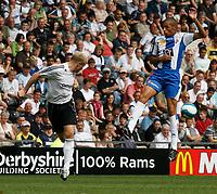 Photo: Steve Bond.<br />Derby County v RCD Espanyol. Pre Season Friendly. 04/08/2007. Jay McEveley heads clear (L) heads clear as Valdo (R) attacks