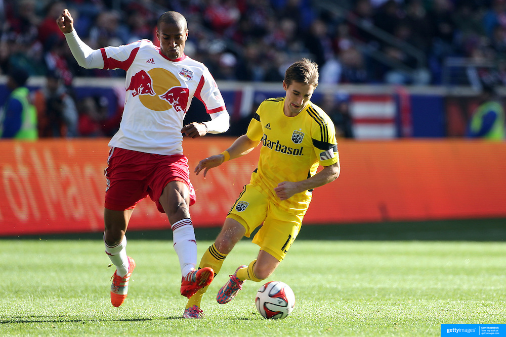 Ethan Finlay, (right), Columbus Crew, is challenged by Roy Miller, New York Red Bulls, during the New York Red Bulls Vs Columbus Crew, Major League Soccer regular season match at Red Bull Arena, Harrison, New Jersey. USA. 19th October 2014. Photo Tim Clayton
