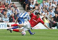 Photo: Paul Thomas.<br /> Nottingham Forest v Huddersfield. Coca Cola Championship.<br /> 06/08/2005.<br /> <br /> Scott Dobie gets tackled by David Mirfin.