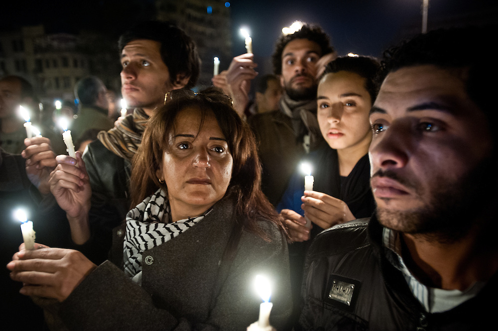 """Egyptian protesters carry vigil candles to honor """"shaheed,"""" or martyrs—those Egyptians who died during protests in Tahrir Square, Cairo. More than three hundred Egyptians perished in protests across the country calling for the ouster of President Hosni Mubarak."""