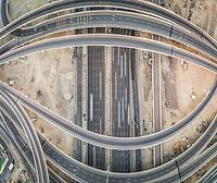 Aerial abstract view of straight and circular roads, Garn Al Sabkha, Dubai, UAE.