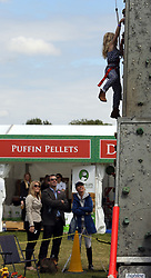 Peter and Autumn Phillips watch daughter Savannah on a climbing wall during the Royal Windsor Horse Show, which is held in the grounds of Windsor Castle in Berkshire.