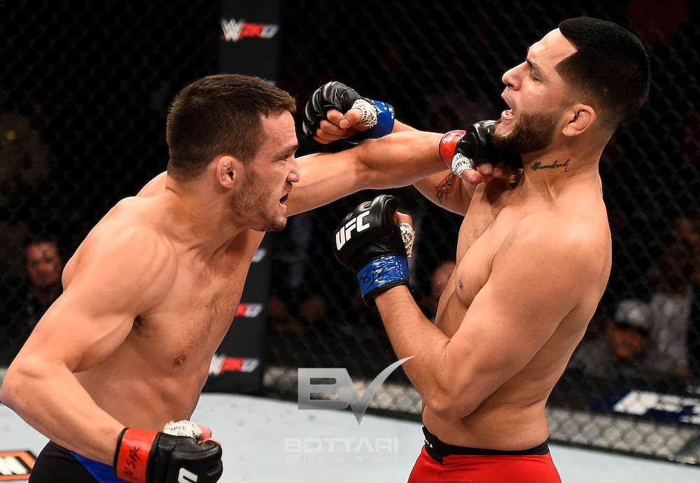 LAS VEGAS, NV - DECEMBER 03:  (L-R) Jake Ellenberger punches Jorge Masvidal in their welterweight bout during The Ultimate Fighter Finale event inside the Pearl concert theater at the Palms Resort & Casino on December 3, 2016 in Las Vegas, Nevada. (Photo by Jeff Bottari/Zuffa LLC/Zuffa LLC via Getty Images)