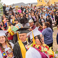 052315  Adron Gardner/Independent<br /> <br /> Tohatchi Cougar seniors walk past a ground of guests for the start of graduation at Tohatchi High School Friday.