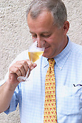 Jean Herve Chiquet, co-owner and co-winemaker tasting a glass of his champagne, Champagne Jacquesson in Dizy, Vallee de la Marne, Champagne, Marne, Ardennes, France