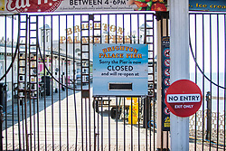 © Licensed to London News Pictures. 27/02/2021. Brighton, UK. The Brighton and Hove Palace Pier remains closed until the Coronavirus lockdown restrictions ease. Photo credit: Hugo Michiels/LNP