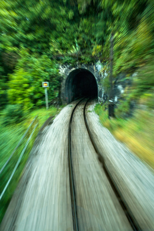 Railway tunnel between Montreux and Gstaad with slow shutter speed for motion blur.  Licensing and Open Edition Prints.
