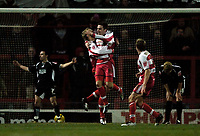 Photo: Jed Wee.<br />Doncaster Rovers v Swansea City. Coca Cola League 1.<br />17/12/2005.<br />Doncaster's Paul Hefferman celebrates the winning goal as Swansea show their dejection.