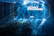 A crowd of Chinese youths cheer as DJ Benny Benassi plays at the Storm Music Festival, a gathering of big names in electronic music  in Shanghai, China on 12 December 2013.