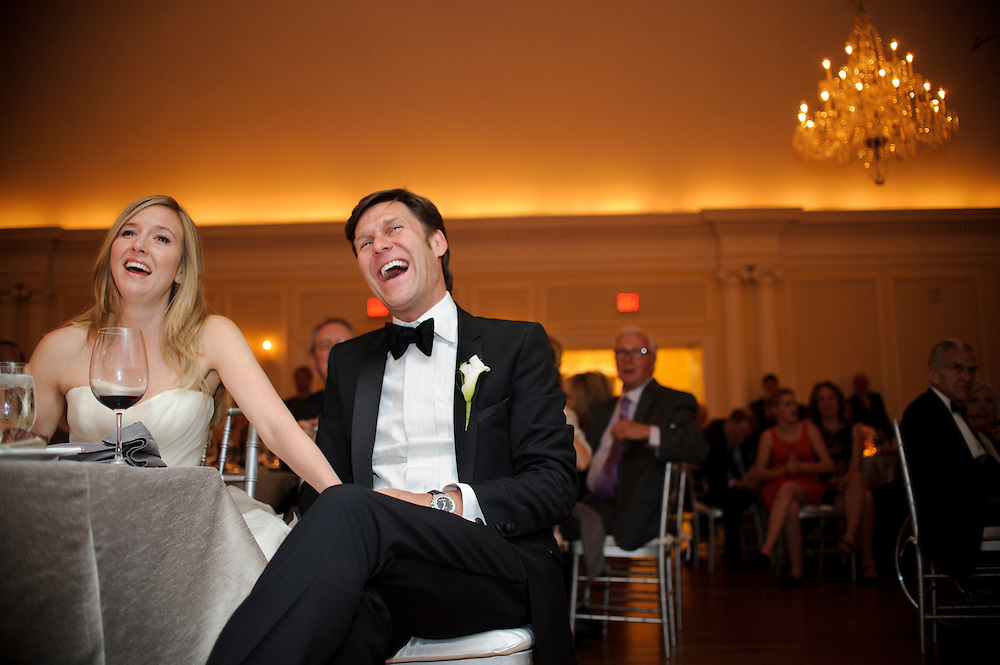 photo by Matt Roth.Saturday, April 14, 2012.Assignment ID: 30124225A..Molly Spencer Palmer and Lee Cowan laugh during a humorous speech .told by one of Lee's best men Mark Hudspeth about how couple's romance sparked while covering the Balloon Boy story in 2009, during their wedding reception at the Chevy Chase Club in Washington D.C. Saturday, April 14, 2012...Molly Palmer, 29, and Lee Cowan, 46, were colleagues at NBC News, but it wasn't until The Balloon Boy story coverage in 2009 that their romance sparked.