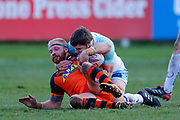 Castleford Tigers second row Oliver Holmes (11) is stopped  during the Betfred Super League match between Castleford Tigers and Widnes Vikings at the Jungle, Castleford, United Kingdom on 11 February 2018. Picture by Simon Davies.