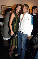 RICK PARFITT JNR and HENRIETTA DUPS at the opening of an exhibition of paintings and watercolours by Raoul Dufy held at the Opera Gallery, 134 New Bond Street, London W1 on 6th February 2006.<br /><br />NON EXCLUSIVE - WORLD RIGHTS